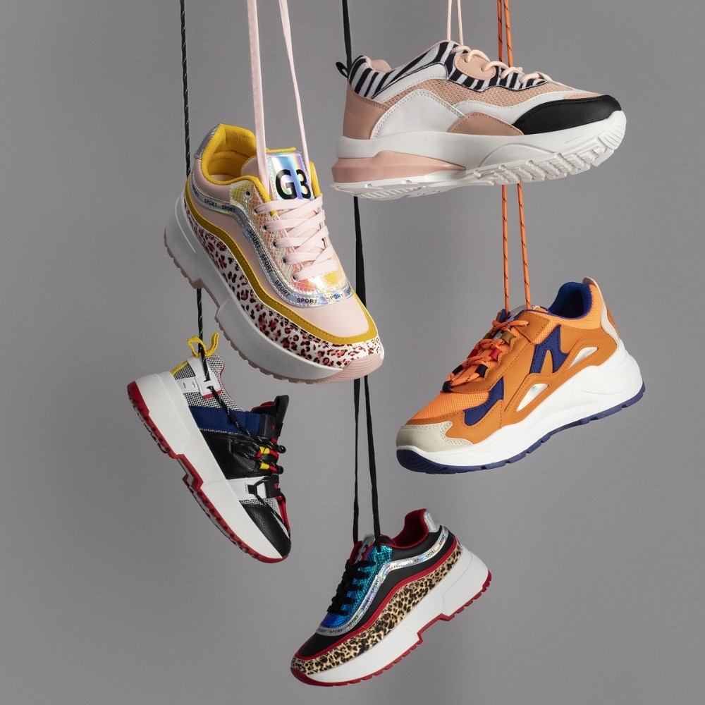 colourful sneakers hanging by their laces